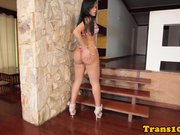 Latina tgirl posing before jumping on cock