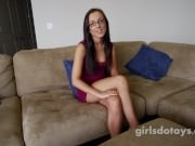 Young cute petite brunette with glasses plays with herself
