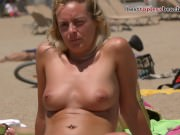 Dazzling blonde Topless on the Beach